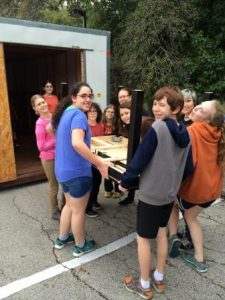 The students load their first donation into the trailer.