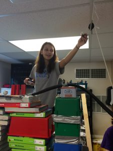 Sarah sets up a pulley system.