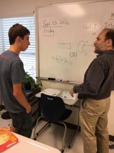 Nir meets with Professor Distler to discuss his idea of a magnetic generator.